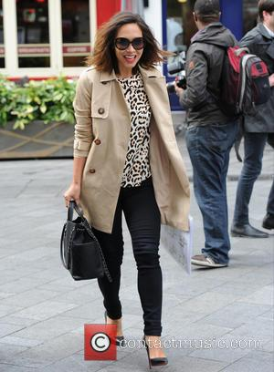Myleene Klass - Myleene Klass seen out in London on her way to Smooth Radio holding a contact sheet of...