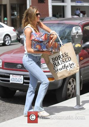 Rhea Durham - Rhea Durham carries an armful of gifts to a salon in Beverly Hills - Los Angeles, California,...