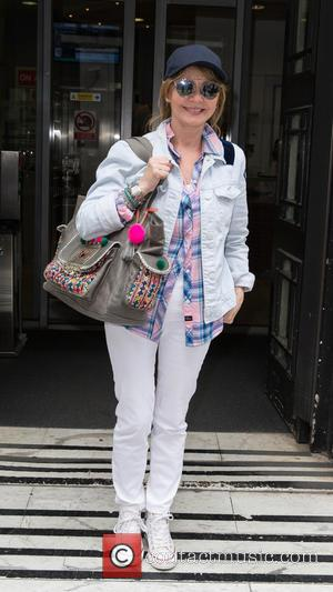 Lulu - Lulu pictured arriving at the Radio 2 studio at BBC Western House - London, United Kingdom - Friday...