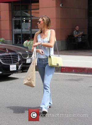 Rhea Durham - Rhea Durham spotted out shopping on Bedford Drive in Beverly Hills, carrying a lime green Chanel purse...