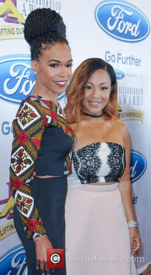 Michelle Williams , Erica Campbell - Steve Harvey presents the 13th Neighborhood Awards at Philips Arena - Arrivals - Atlanta,...
