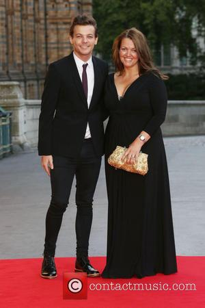 Louis Tomlinson with his Mother Johannah Deakin at the Believe In Magic Cinderella Ball held at the Natural History Museum...