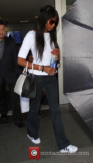 Naomi Campbell - Naomi Campbell arrives at Los Angeles International Airport (LAX) - Los Angeles, California, United States - Monday...