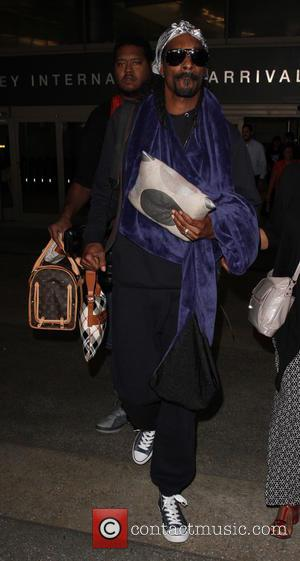 Snoop Lion , Snoop Dogg - Snoop Dogg arrives at Los Angeles International Airport (LAX) - Los Angeles, California, United...