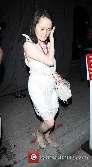 Soon-Yi Previn - Woody Allen signs autographs has he leaves Craig's with wife Soon-Yi, while Courteney Cox arrives by herself...