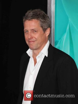 Hugh Grant - New York premiere of 'The Man From U.N.C.L.E.' at The Ziegfeld Theater - Red Carpet Arrivals at...
