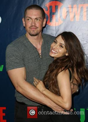 Steve Howey and Sarah Shahi