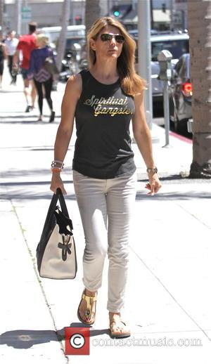 Lori Loughlin - Lori Loughlin goes shopping in Beverly Hills wearing a 'Spiritual Gangster' t-shirt - Los Angeles, California, United...