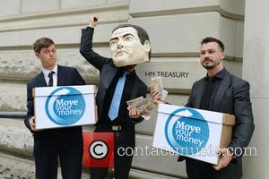 Atmosphere - 'Move Your Money UK' protest at RBS sell off. Campaign group 'Move Your Money' protest outside the Treasury...