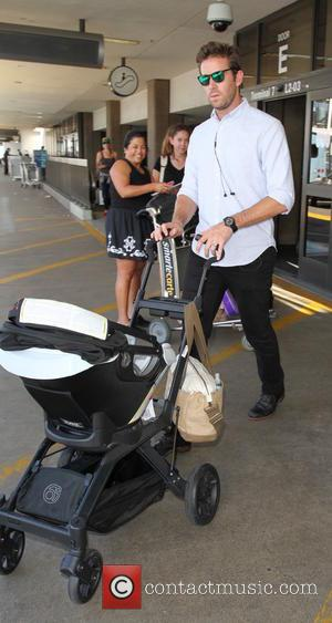 Armie Hammer - Armie Hammer arrives at Los Angeles International Airport (LAX) with family - Los Angeles, California, United States...