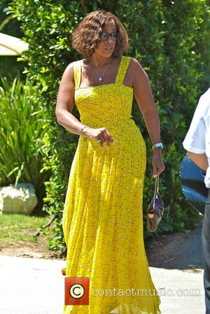 Gayle King - Gayle King arrives at a gifting suite in Brentwood wearing a full length yellow summer dress -...