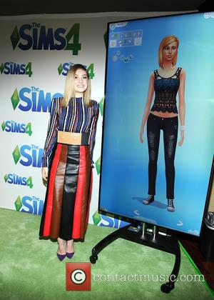 Willow Shields - Willow Shields poses next to her Sim in The Sims 4 backstage area at the Teen Choice...
