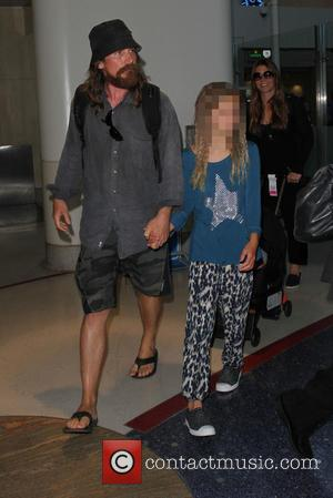 Christian Bale , Emmeline Bale - A scruffy Christian Bale arrives at Los Angeles International Airport (LAX). Sporting a straggly...