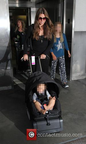 Sibi Blazic, Emmeline Bale , Joseph Bale - A scruffy Christian Bale arrives at Los Angeles International Airport (LAX). Sporting...