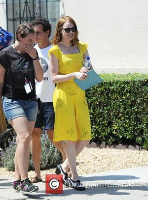 Emma Stone - Actress Emma Stone wearing a bright yellow vintage dress for a scene in her upcoming movie 'La...
