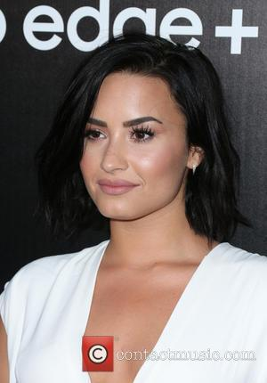 Demi Lovato Celebrates 23rd Birthday With New Puppy 'Batman' And A Tribute From Kelly Clarkson