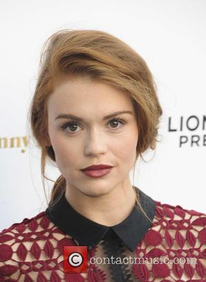 Holland Roden - Los Angeles Premiere of 'She's Funny That Way' at Harmony Gold - Red Carpet Arrivals - Los...
