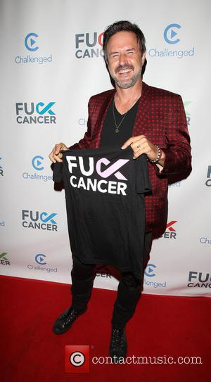 David Arquette - David Arquette holding a t-shirt supporting 'Fuck Cancer' at Bootsy Bellows - Los Angeles, California, United States...