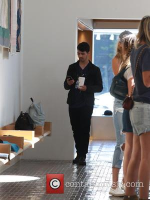 Joe Jonas - Joe Jonas and Gigi Hadid were shopping in Beverly Hills - Beverly Hills, California, United States -...