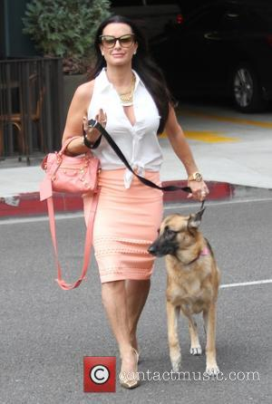 Kyle Richards - Kyle Richards takes her dog for a walk in Beverly Hills - Los Angeles, California, United States...