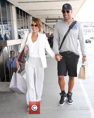 Boris Kodjoe , Nicole Ari Parker - Boris Kodjoe and his wife Nicole Ari Parker arrive at Los Angeles International...