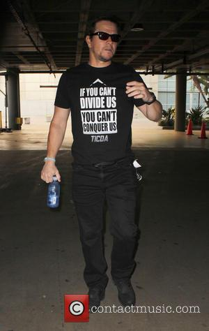 Mark Wahlberg - Celebrities arrive to watch Taylor Swift in concert at the Staples Center at Staples Center - Los...