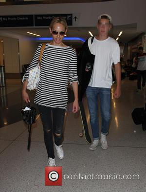 Amber Valletta , Auden McCaw - Amber Valletta and son Auden at Los Angeles International Airport (LAX) - Los Angeles,...