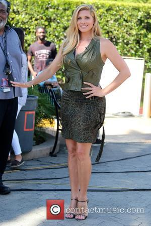 Candis Cayne - Candis Cayne appears on 'Extra' at Universal Studios - Los Angeles, California, United States - Monday 24th...