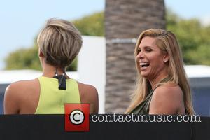 Candis Cayne , Charissa Thompson - Candis Cayne  appears on 'Extra' at Universal Studios - Los Angeles, California, United...