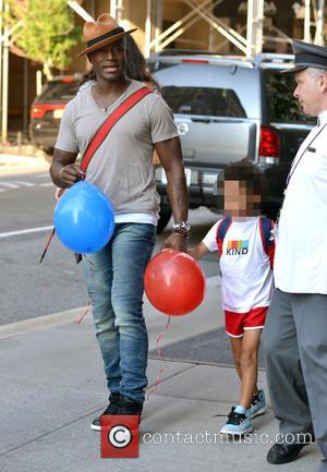 Taye Diggs , Walker Nathaniel Diggs - Taye Diggs and his son Walker, out and about in Manhattan catching the...