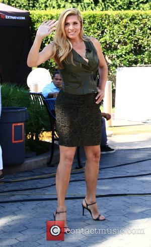 Candis Cayne - Candid Cayne appears on 'Extra' at Universal Studios Hollywood - Los Angeles, California, United States - Monday...