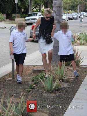 Sharon Stone, Quinn Kelly Stone , Laird Vonne Stone - Sharon Stone out with her sons in Beverley Hills crosses...