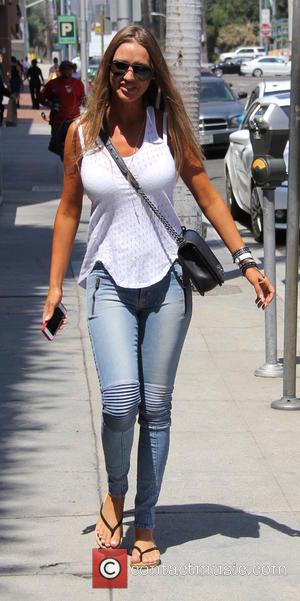 Charlie Riina - Playboy model Charlie Riina out and about in Beverly Hills in jeans, flip flops and a white...