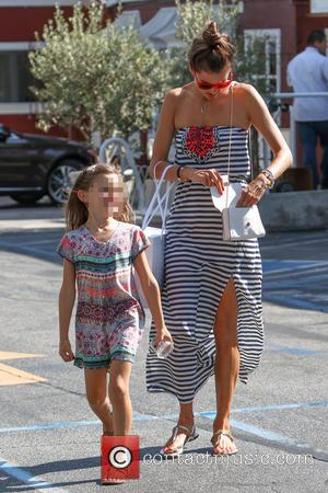 Alessandra Ambrosio , Anja Mazur - Alessandra Ambrosio leaving the Brentwood Country Mart with her daughter in Los Angeles -...