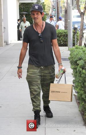 Lukas Haas - Lukas Haas shops in Beverly Hills and changes his t-shirt half way through his trip at beverly...