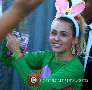 Miley Cyrus - Miley Cyrus seen leaving ABC studios after Jimmy Kimmel Live wearing bright colours and bunny ears -...
