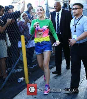 Miley Cyrus - Miley Cyrus signs autographs and chats with fans after her appearance on Jimmy Kimmel Live! at Jimmy...