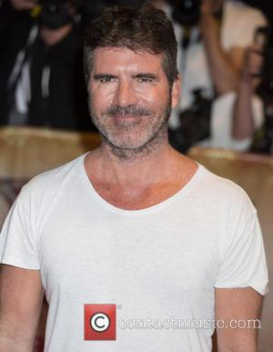 Simon Cowell Reportedly Makes A Crisis Call To Louis Walsh