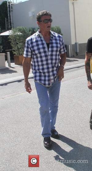 Sylvester Stallone - Sylvester Stallone has lunch with friends at Cafe Roma in Beverly Hills - Los Angeles, California, United...