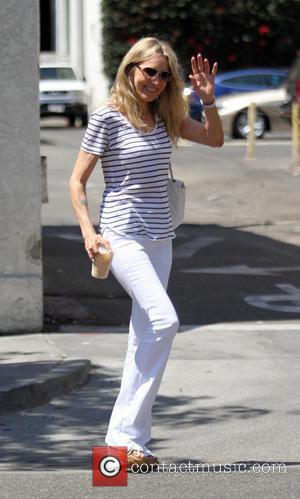 Alana Stewart - Alana Stewart wearing a nautical blue stip t shirt with white trousers goes out and about running...
