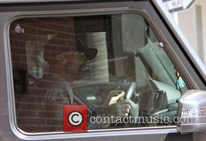 Adam Levine - Adam Levine out driving in Los Angeles at beverly hills - Los Angeles, California, United States -...