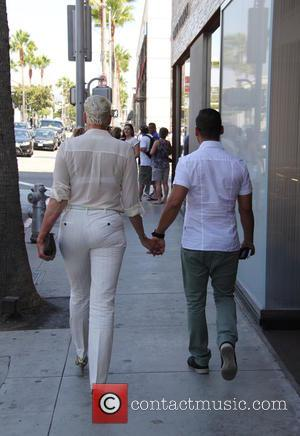 Brigitte Nielsen , Mattia Dessì - Brigitte Nielsen spotted out in Beverly Hills, holding hands with her husband Mattia Dessì...