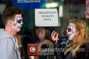 View , Atmosphere - A couple with painted faces collect their tickets for Film4 Frightfest 2015 at the Vue cinema...