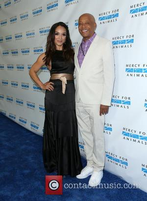 Mayte Garcia and Russell Simmons