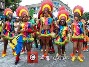 View , Atmosphere - Performers in costumes during the Notting Hill Carnival 2015 Children's Day. This year's event is in...