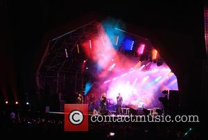 Gary Barlow, Howard Donald , Mark Owen - Take That close Carfest festival cars and music - Guilford, United Kingdom...
