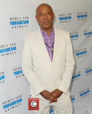 Russell Simmons Reaches Settlement Over Rushcard Lawsuit