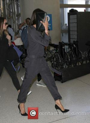 Victoria Beckham - David Beckham, wife Victoria and their four children arrive at Los Angeles International Airport (LAX) at Los...