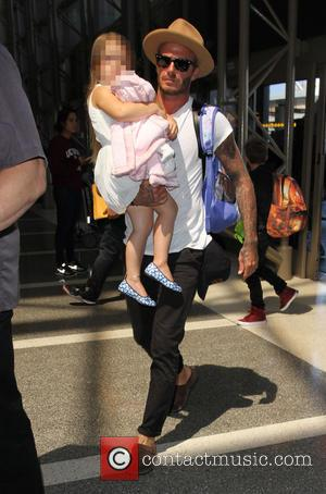 David Beckham , Harper Beckham - David Beckham, wife Victoria and their four children arrive at Los Angeles International Airport...