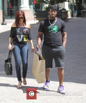 Yasiel Puig , Andrea de la Torre - Baseball player Yasiel Puig and girlfriend, Andrea de la Torre shopping in...